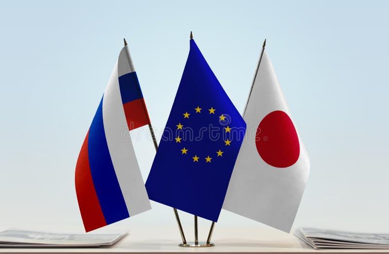 Флаги России EC и Японии стоковые изображения rf