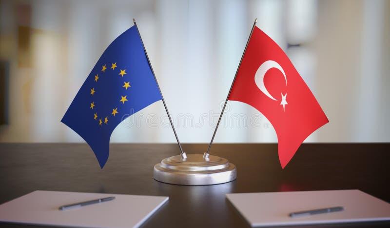 Флаги Турции и ЕС за столом Переговоры между Европейским союзом и Турцией Иллюстрация трехмерной графики стоковое изображение rf