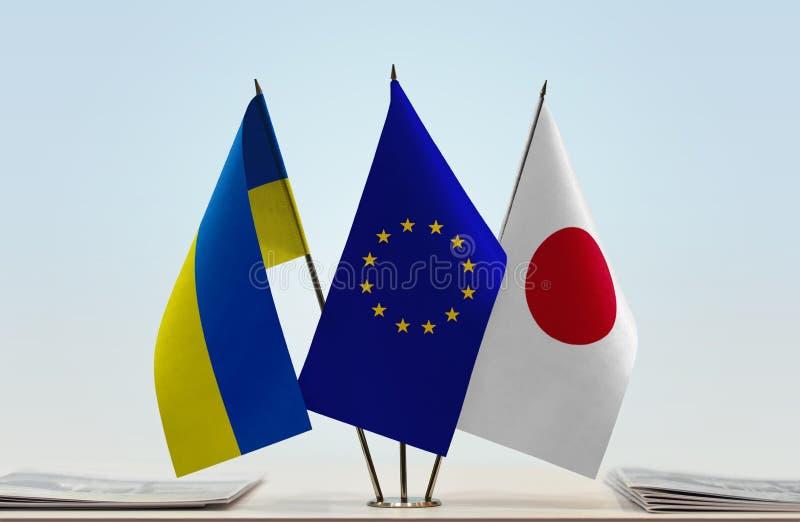 Флаги Украины EC и Японии стоковые фото