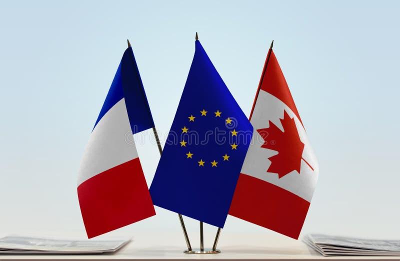 Флаги Франции EC и Канады стоковая фотография rf