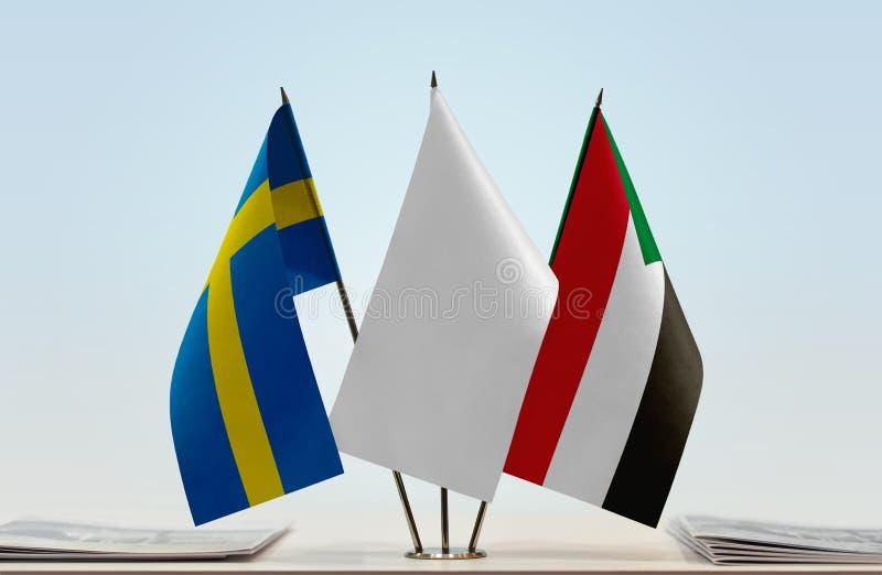 Флаги Швеции и Судана стоковые фото