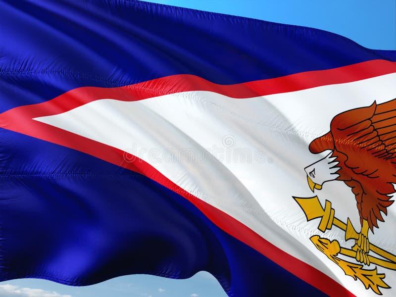 Флаг Американских Самоа развевая в ветре против темносинего неба Высококачественная ткань стоковое изображение rf