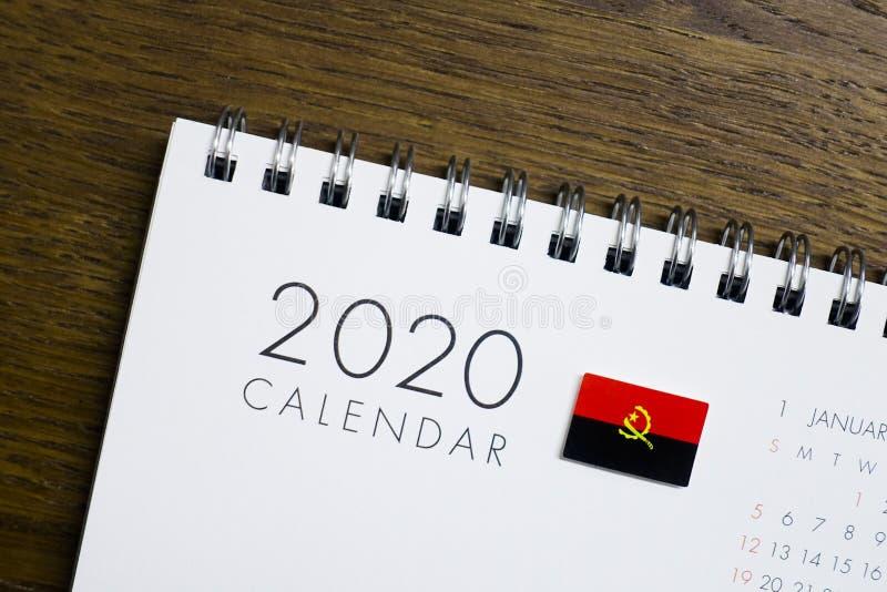Флаг Анголы на календаре 2020 стоковое фото