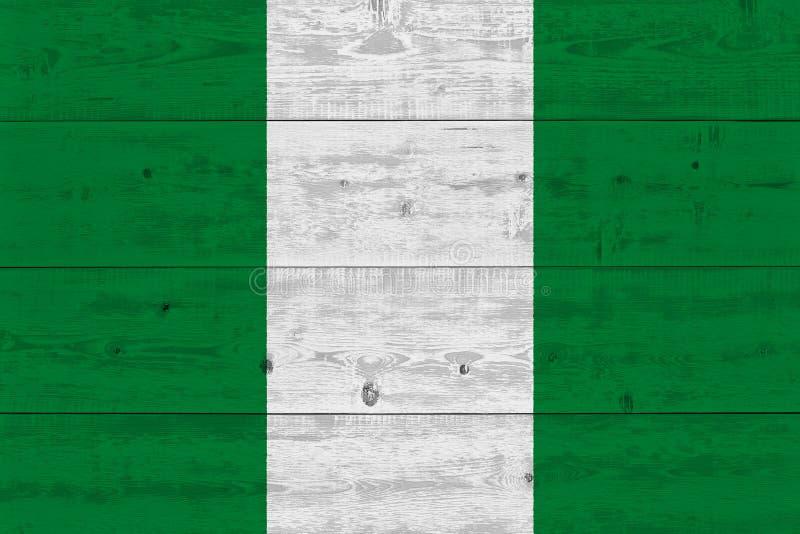 Флаг Нигерии покрашенный на старой деревянной планке стоковые фото