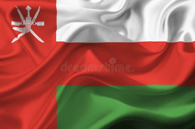 Флаг Омана развевая стоковое фото