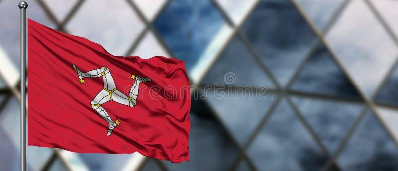 Флаг острова Мэн развевая в ветре против запачканного современного здания r Национальная тема сотрудничества стоковое изображение rf