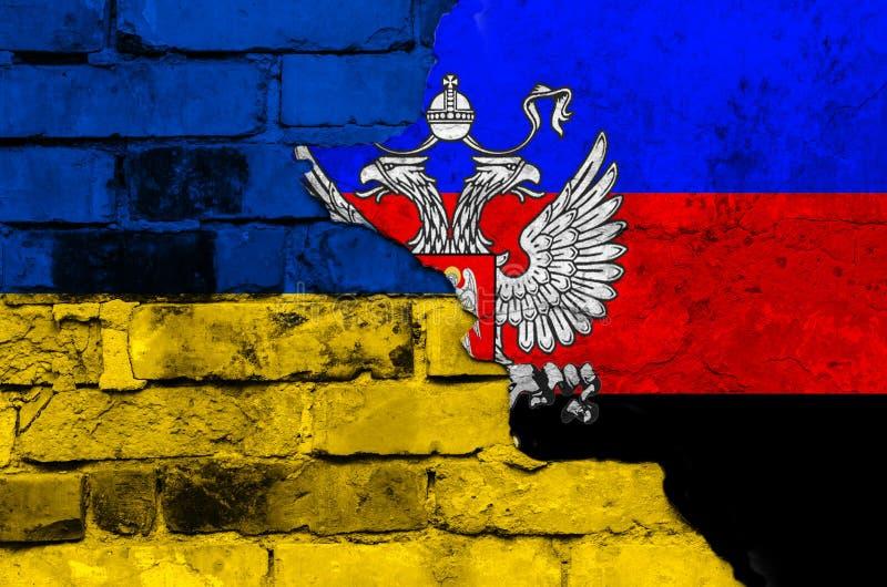 Флаг республики ` s людей Украины и Донецка на текстурированной кирпичной стене стоковое изображение