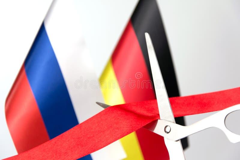 Флаг России Германии ленты шелка отрезков красный стоковые изображения rf