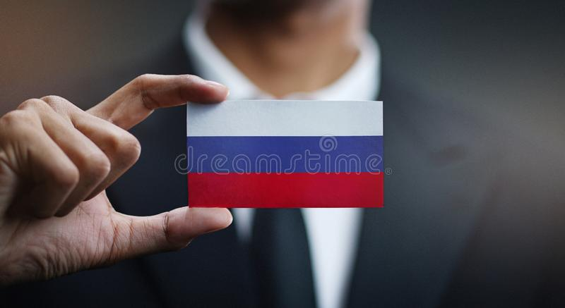 Флаг России карты удерживания бизнесмена стоковая фотография rf