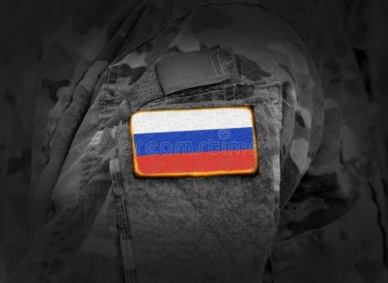 Флаг России на солдатах подготовляет коллаж стоковое изображение rf