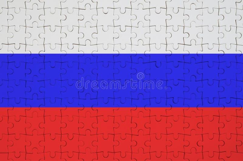 Флаг России показан на сложенной головоломке стоковые фотографии rf