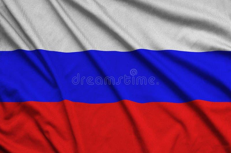 Флаг России показан на ткани ткани спорт с много створок Знамя команды спорта стоковое фото