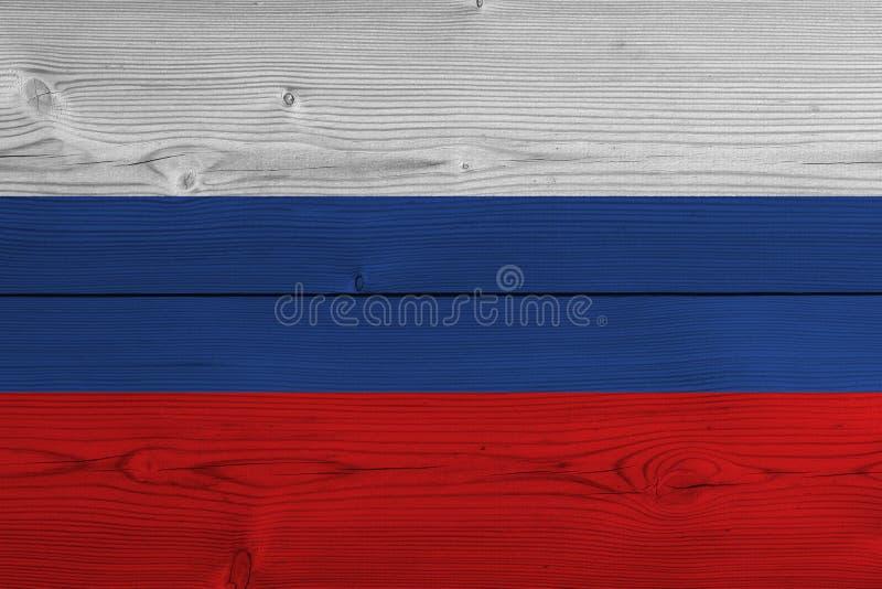 Флаг России покрашенный на старой деревянной планке стоковые изображения