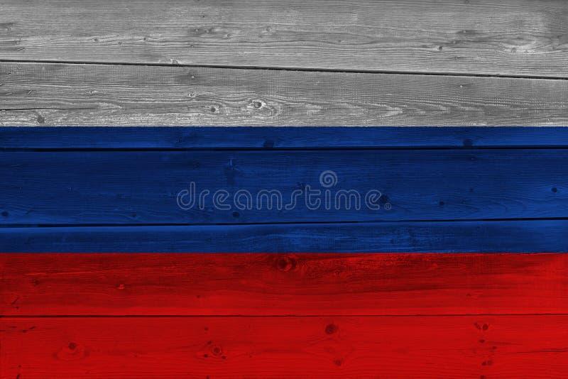 Флаг России покрашенный на старой деревянной планке стоковое фото rf