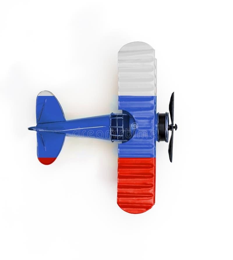 Флаг самолета игрушки металла перемещения России изолированного на белизне стоковое фото