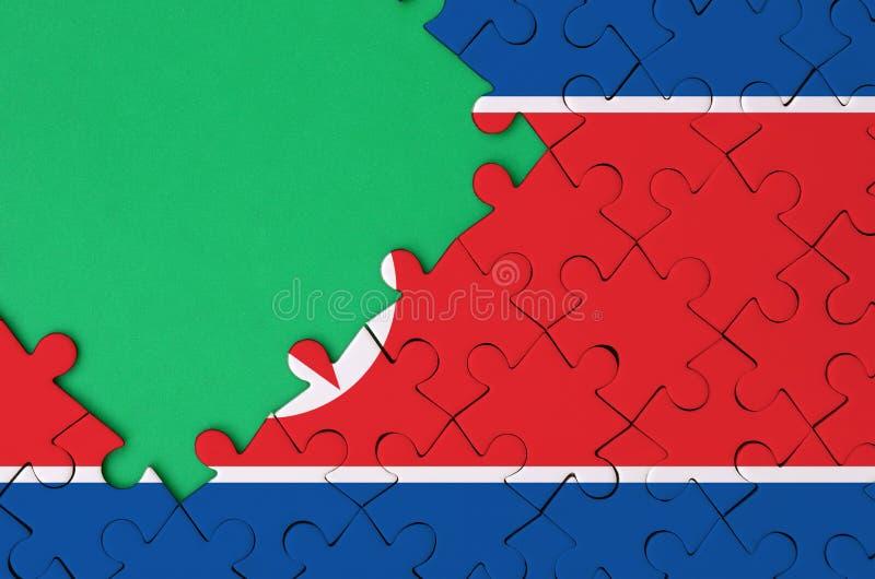 Флаг Северной Кореи показан на завершенной мозаике с свободным зеленым космосом экземпляра на левой стороне стоковые изображения rf