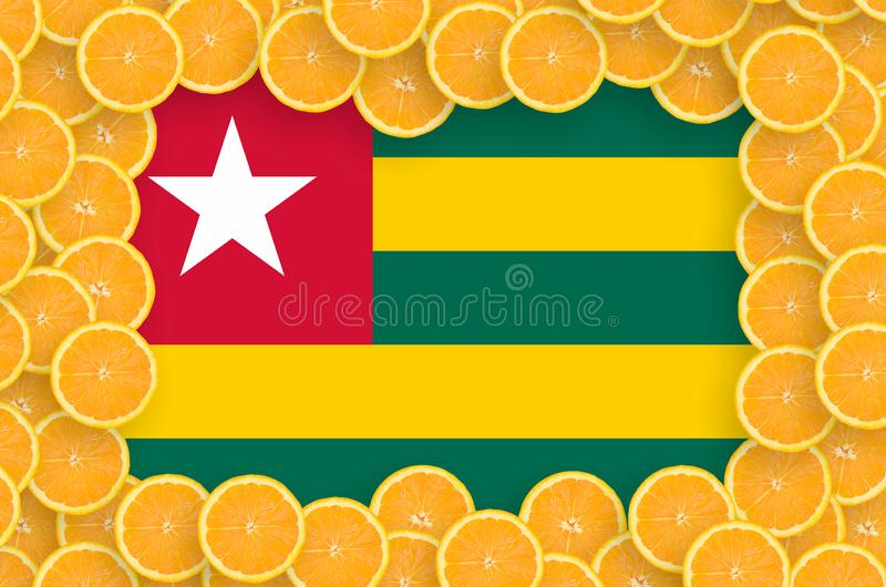 Флаг Того в свежей рамке кусков цитрусовых фруктов бесплатная иллюстрация