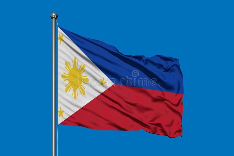 Флаг Филиппин развевая в ветре против темносинего неба Филиппинский флаг стоковое фото rf