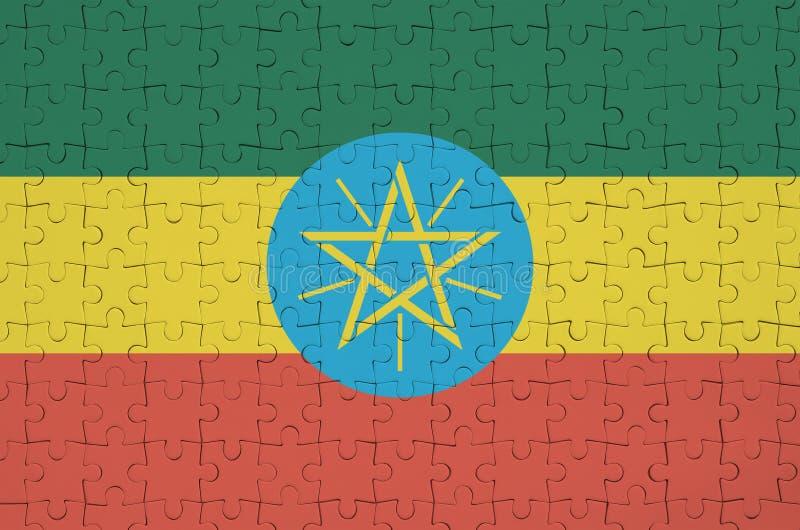 Флаг Эфиопии показан на сложенной головоломке стоковые фотографии rf