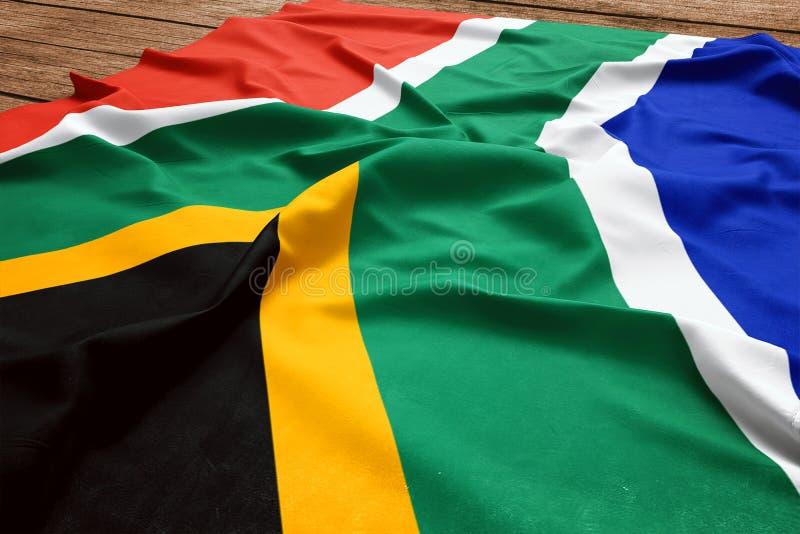 Флаг Южной Африки на деревянной предпосылке стола Взгляд сверху флага шелка южно-африканский стоковое фото