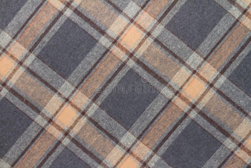 Фланель, хлопок в классическую шотландскую клетку как предпосылка ткани стоковые фото