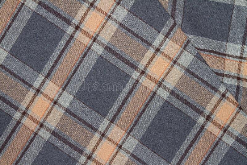 Фланель, хлопок в классическую шотландскую клетку как предпосылка ткани стоковая фотография