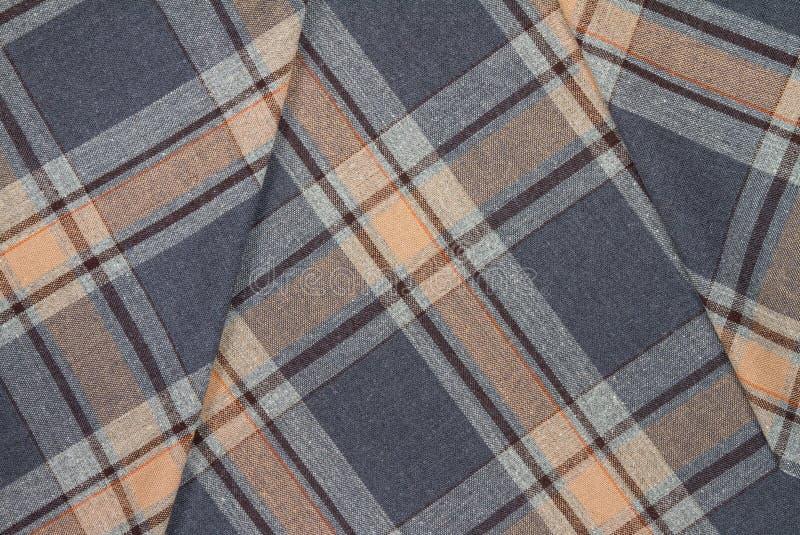 Фланель, хлопок в классическую шотландскую клетку как предпосылка ткани стоковая фотография rf