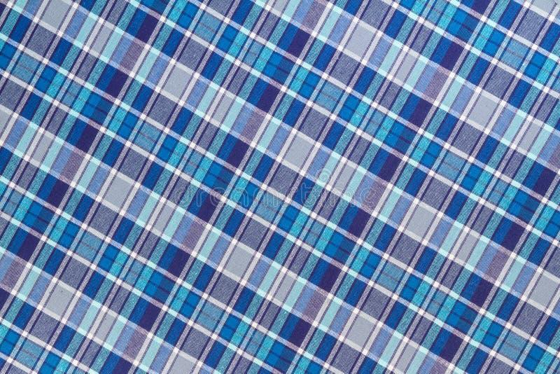Фланель, хлопок в классическую шотландскую клетку как предпосылка ткани стоковое фото