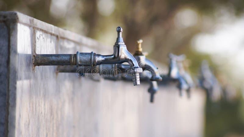 Фокус на Faucet стоковая фотография