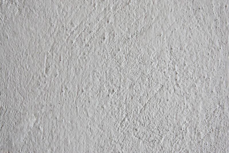 Фоновый неровно-покрытая стена, неровный поверхностный цемент серый стоковое изображение rf