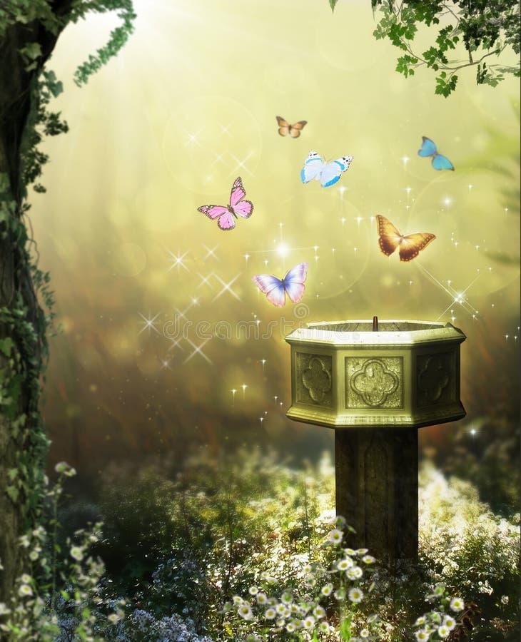 Фонтан сказки в волшебном лесе стоковое фото