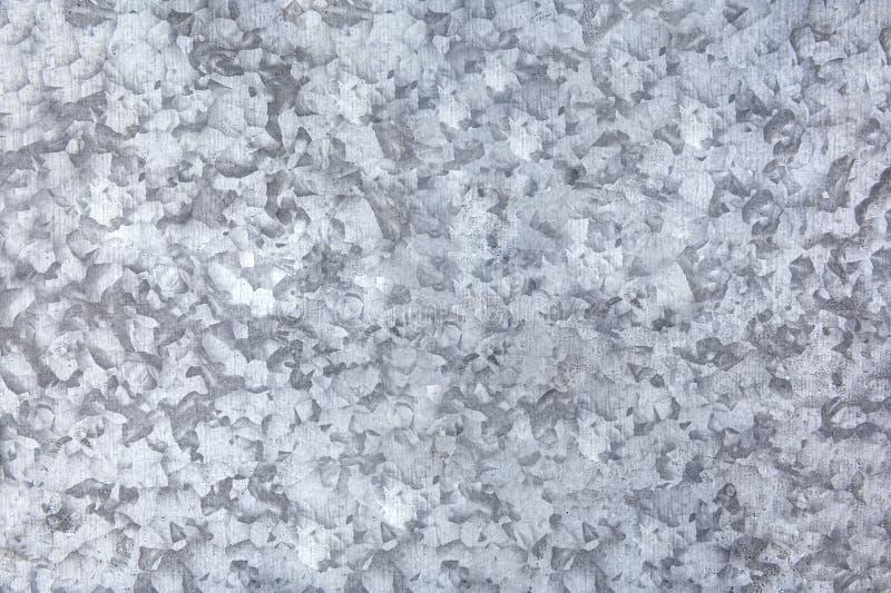 Фон серой пятнистой алюминиевой поверхности доски стоковая фотография
