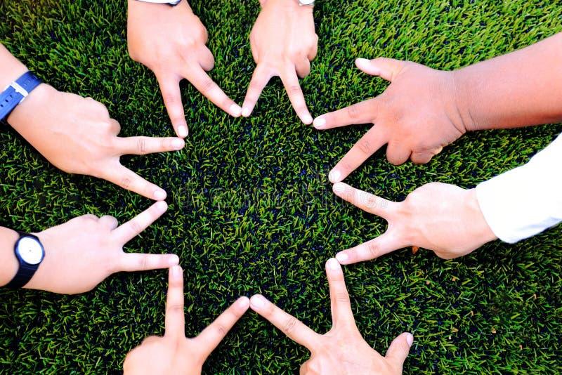 Форма звезды руки для приятельства стоковая фотография rf