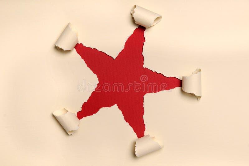 формировать сорванный бумагой желтый цвет звезды стоковые фото