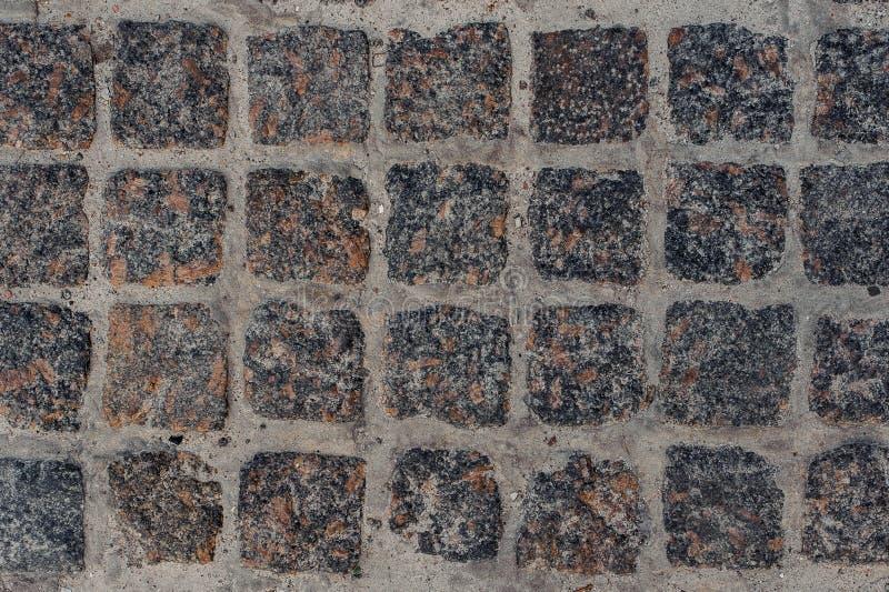 Фотография макроса серой каменной мостоваой дороги блока стоковая фотография rf