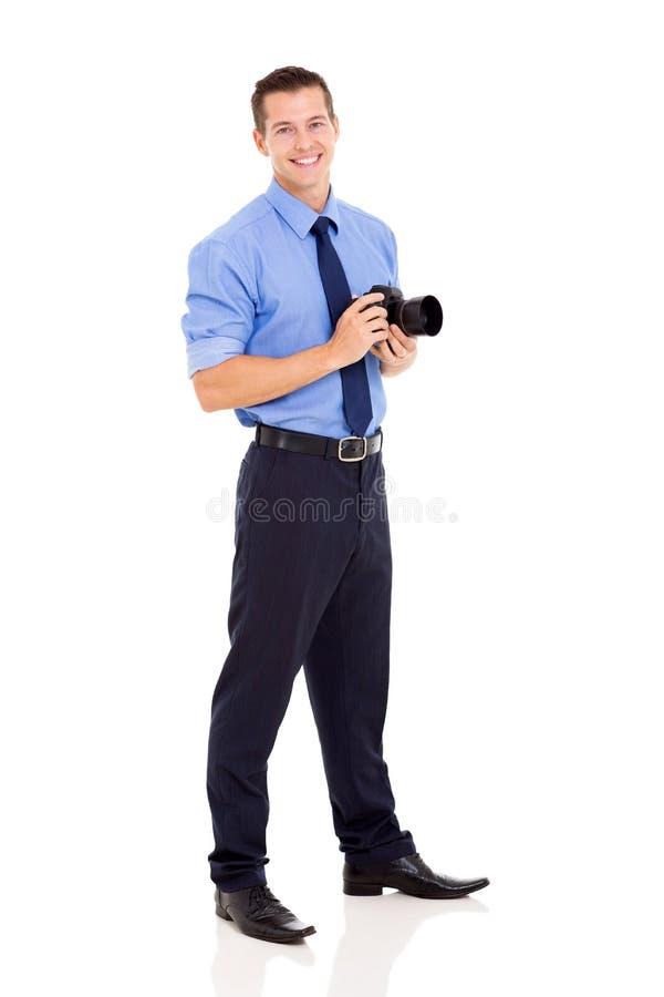 Фотограф стоя на белизне стоковые изображения rf