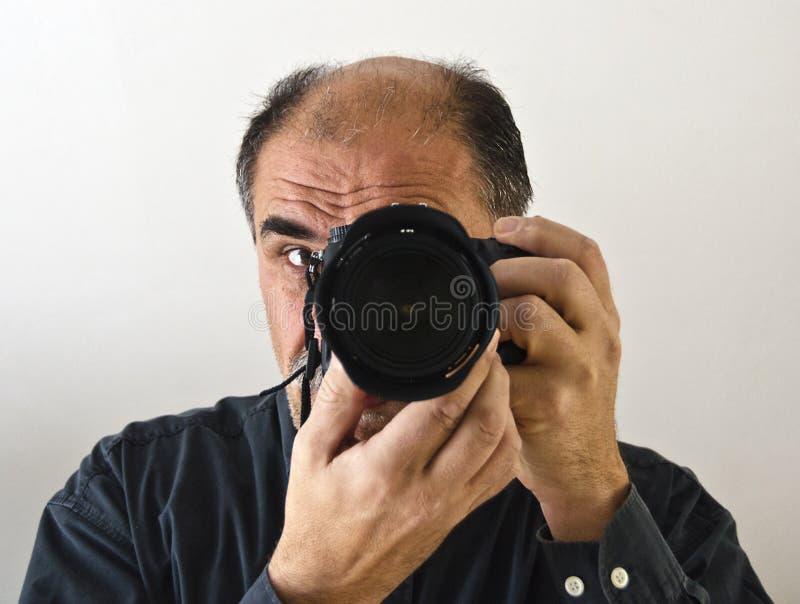 Фотограф с камерой стоковое фото rf