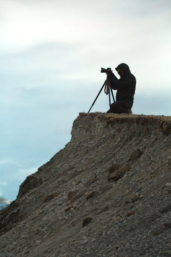 Фотограф с треногой стоковая фотография