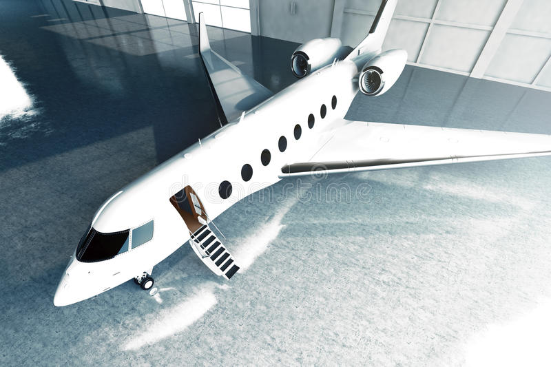 Фото белой лоснистой роскошной родовой автостоянки частного самолета дизайна в авиапорте ангара конкретный пол детеныши женщины п стоковая фотография
