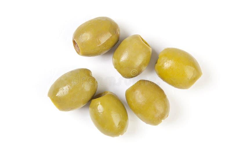 Зеленые оливки на белой предпосылке фото варианта для упаковки стоковая фотография rf