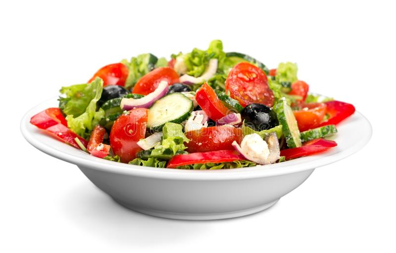 Фото конца-вверх свежего салата с овощами внутри стоковое фото rf