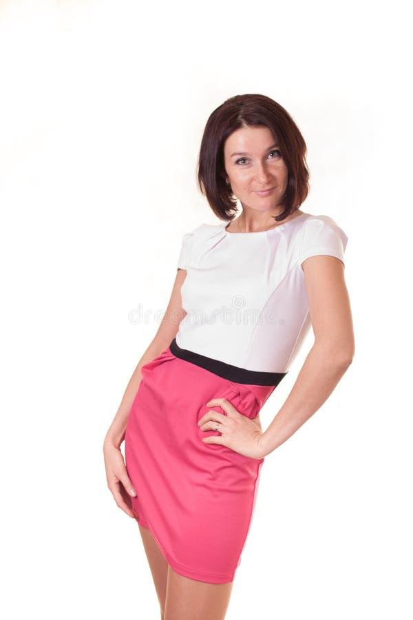 Молодая дама изолированная на белой предпосылке стоковое фото