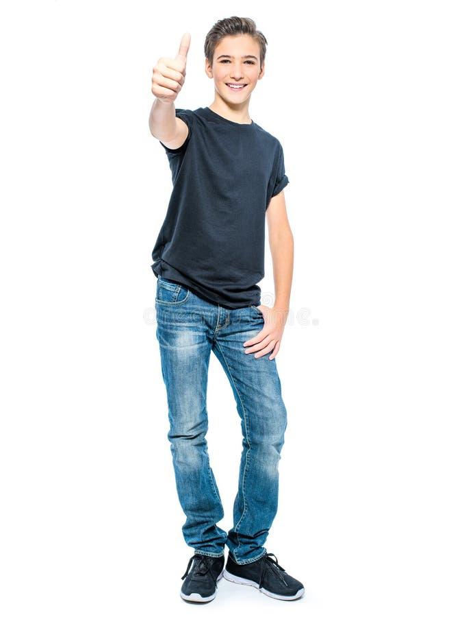 Фото подростка с большим пальцем руки вверх стоковое изображение rf