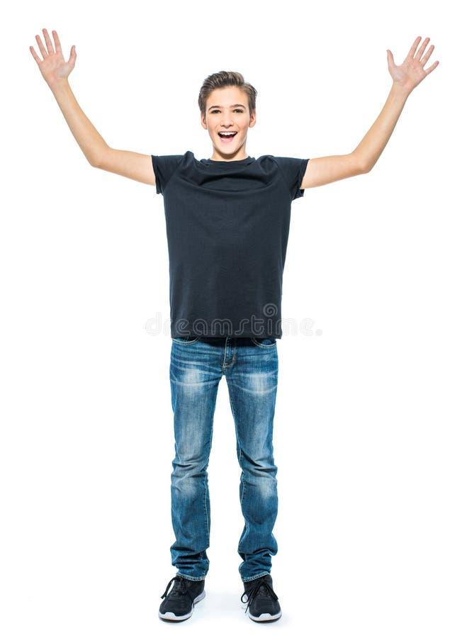 Фото счастливого подростка с руками вверх стоковые изображения