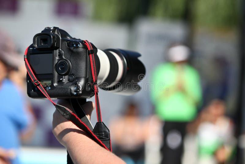 фото удерживания камеры стоковое изображение