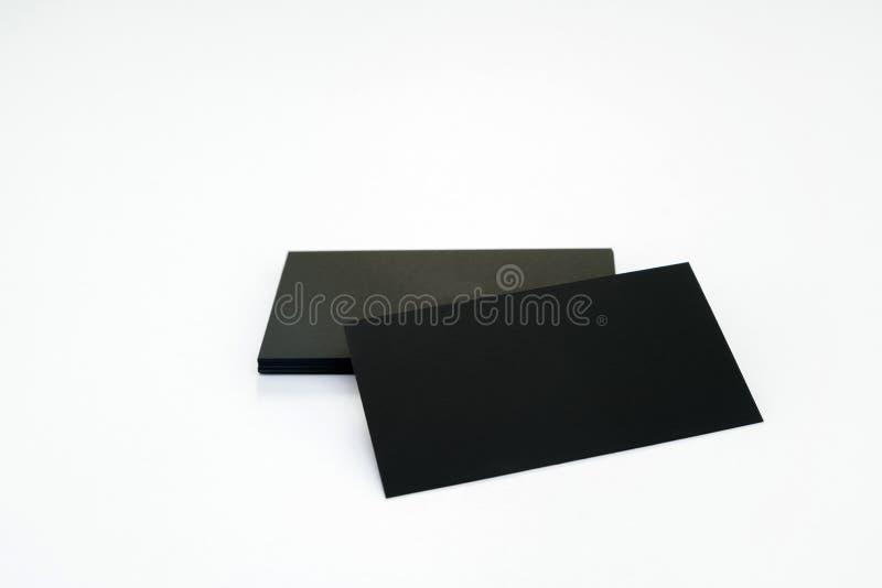 Фото черных пустых визитных карточек на белой предпосылке Templ стоковые изображения rf
