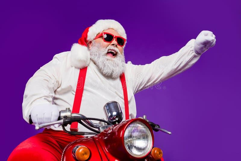 Фото santa Claus role man fast ride newyear party by велосипед взволнованный видеть друзей, использующих суперсилы для быстрых хо стоковая фотография rf