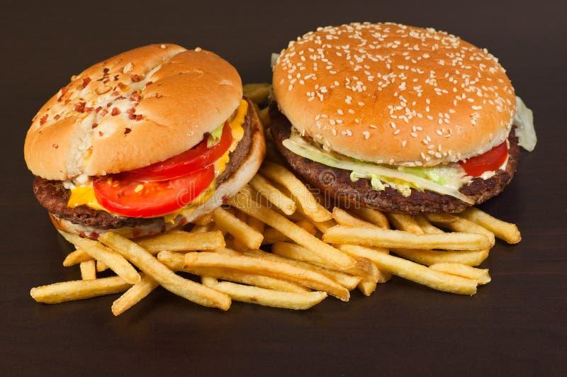 Фраи гамбургера и француза фаст-фуда установленные большие стоковые фото
