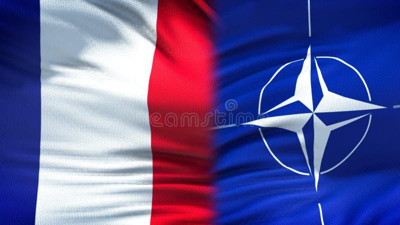 Франция и предпосылка флагов НАТО, дипломатический и экономические отношения, безопасность стоковые фото