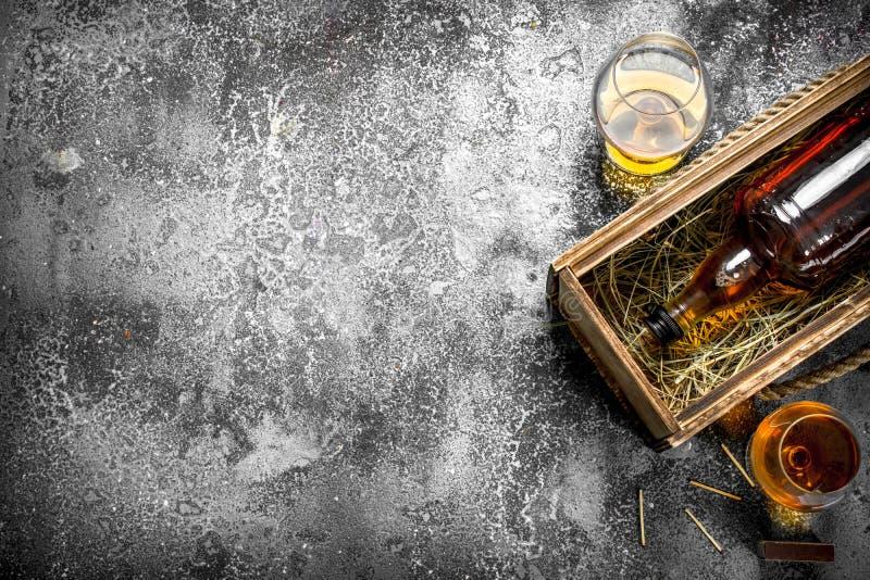 Французский коньяк в старой коробке стоковое фото rf